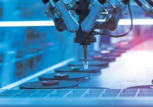 Consumer goods conveyor with a robotic arm