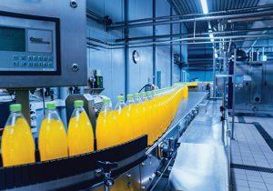 Beverage conveyor moving bottles
